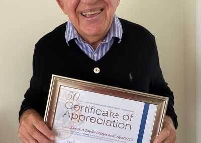 Photo of HHLC member Derek Taylor, receiving a certificate of 50 years appreciation, signed by The Countess of Wessex.