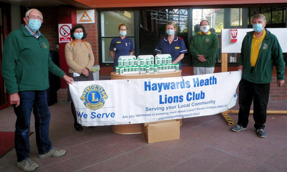 Haywards Heath Lions Club members giving out free message in a bottle kits at the Princess Royal Hospital