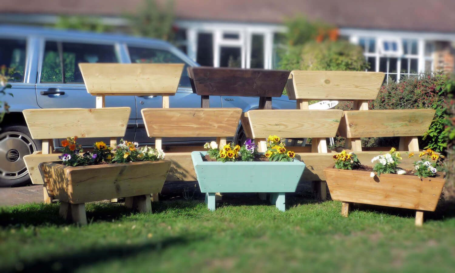 Photo of some of the Wooden Garden Planters that HHLC are selling to raise funds for our charity.