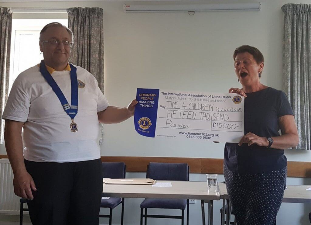 Photo of Haywards Heath Lions Club presenting the Time 4 Children with a donation cheque