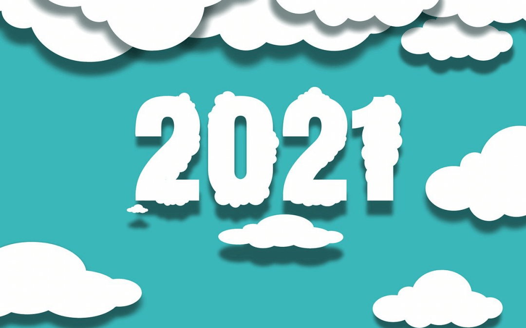 Image showing the year 2021 as white clouds, over a blue sky background.