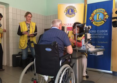 A man receives an eye test as part of the Lions Club SightFirst programme